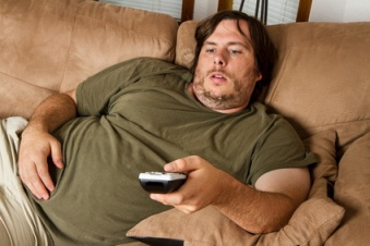 Fat lazy guy on the couch